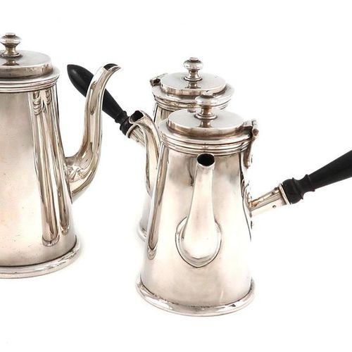 A suite of three silver cafe au lait pots, by the Harrison Brothers, London 1910…