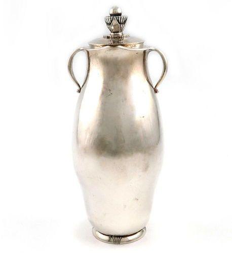 Designed by Gundorph Albertus for Georg Jensen, a Danish silver cocktail shaker,…