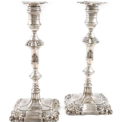 A pair of Edwardian silver candlesticks, by The Goldsmiths and Silversmiths Comp…