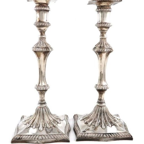 A pair of George III silver candlesticks, probably by John Carter, London 1770, …