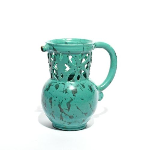 A French faïence puzzle jug late 18th century, probably Le Croisic, decorated al…