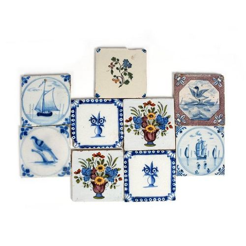 Nine delftware tiles 18th century, two painted in blue with boats at sea, a pair…