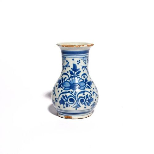 A small London delftware vase c.1700 20, the bottle shaped body painted in under…