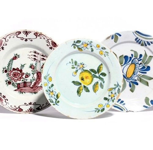 Three delftware plates 18th century, Dutch and English, the smallest painted wit…