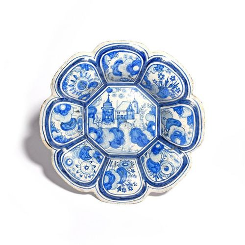A Delft or German faïence lobed dish or buckelplatte c.1650 80, the octagonal we…