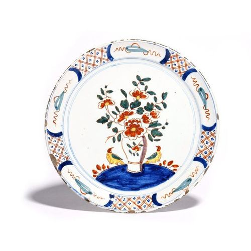A Delft plate c.1720, of pancake form, brightly painted in polychrome enamels wi…
