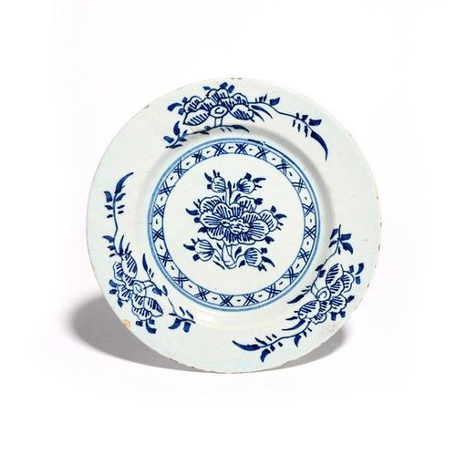 A small London delftware plate c.1730 40, painted in blue with a central spray o…