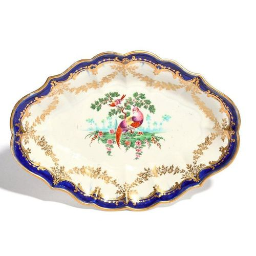 A Worcester dessert dish c.1770 80, painted to the well with an exotic bird stan…