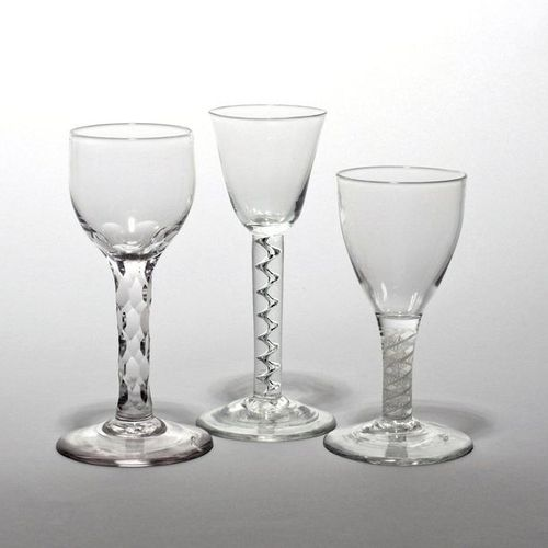 Three wine glasses c.1760, one with a rounded funnel bowl raised on a corkscrew …