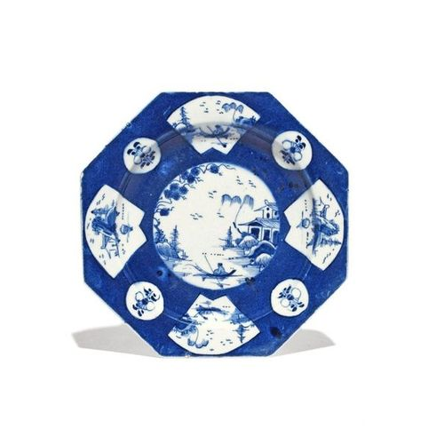 A Bow blue and white octagonal plate c.1765, painted with a central Chinese land…