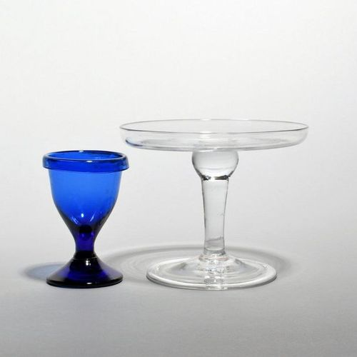 A small glass tazza mid 18th century, the shallow bowl raised on a plain stem wi…