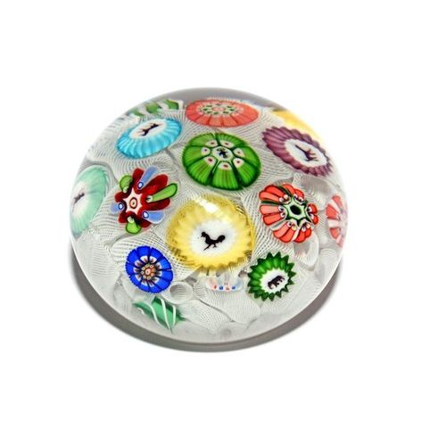 A Baccarat spaced millefiori paperweight dated 1848, set with thirteen individua…