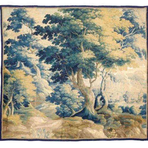 A FLEMISH VERDURE TAPESTRY 17TH CENTURY worked with trees and with a castle in t…