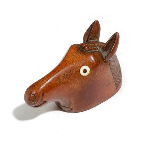 A TREEN HORSE'S HEAD SNUFF BOX C.1840 naively carved with bone inset eyes, the u…