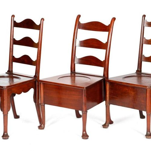 THREE GEORGE II MAHOGANY COMMODE CHAIRS C.1740 50 each with a shaped ladder back…