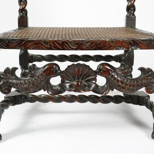 A WALNUT OPEN ARMCHAIR IN WILLIAM AND MARY STYLE 19TH CENTURY carved with crowns…
