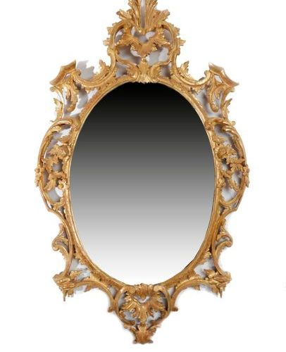 A GEORGE III GILTWOOD WALL MIRROR C.1770 AND LATER the later oval plate within a…