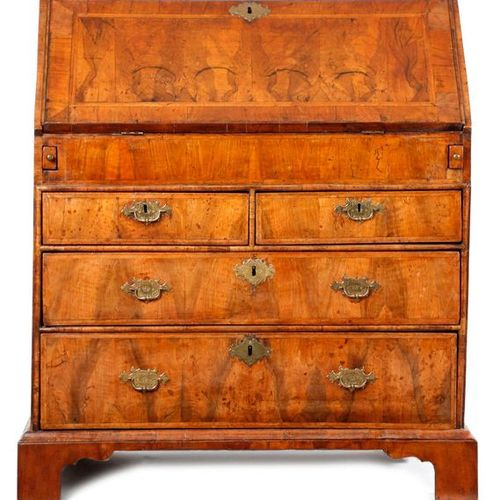 A GEORGE I WALNUT BUREAU C.1715 with cross and feather banding, the hinged fall …