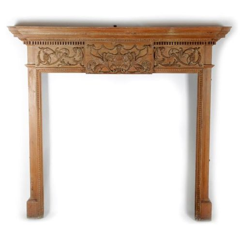 A CARVED PINE FIRE SURROUND / CHIMNEY PIECE IN ADAM STYLE LATE 19TH CENTURY the …