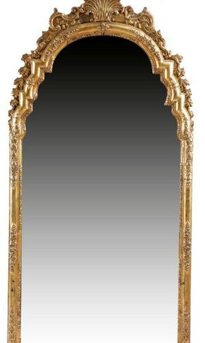 A GILTWOOD AND GESSO WALL MIRROR IN QUEEN ANNE STYLE EARLY 18TH CENTURY AND LATE…