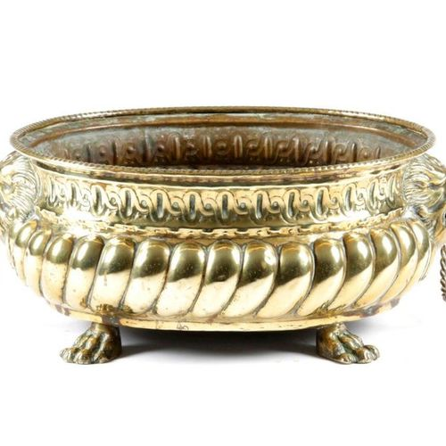 A DUTCH BRASS OVAL JARDINIERE 19TH CENTURY with repousse decoration, lion's mask…