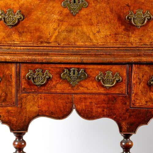 A QUEEN ANNE WALNUT CHEST ON STAND C.1710 with two short and three long feather …