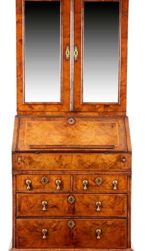 A GEORGE I WALNUT BUREAU BOOKCASE C.1715 20 with cross and feather banding, the …