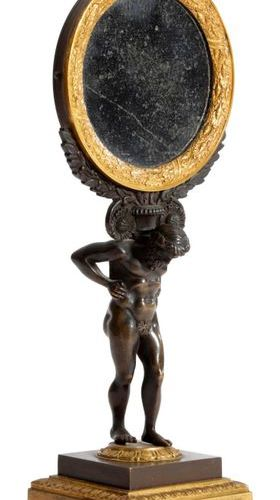 A FRENCH 'EMPIRE' GILT AND PATINATED BRONZE TABLE MIRROR C.1810 20 modelled with…