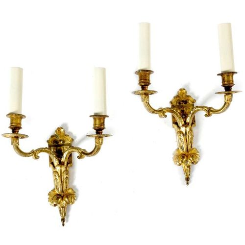 A PAIR OF FRENCH ORMOLU TWIN LIGHT WALL LIGHTS IN REGENCE STYLE decorated with l…
