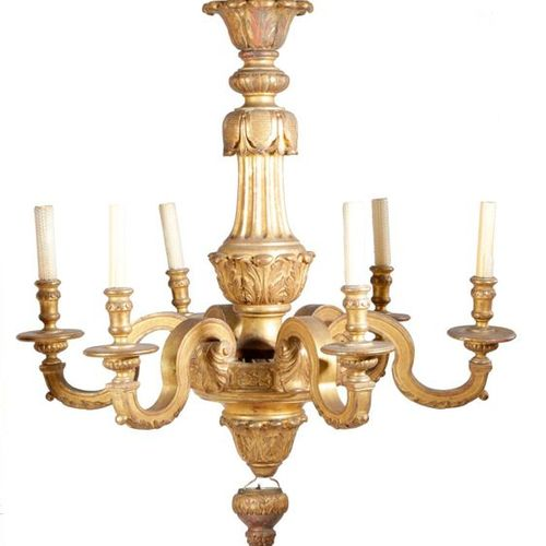 A CARVED GILTWOOD SIX LIGHT CHANDELIER IN GEORGE II STYLE LATE 19TH / EARLY 20TH…