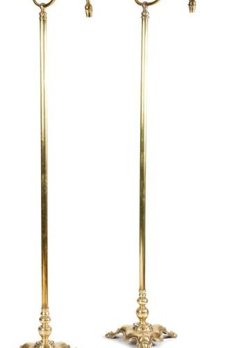 A PAIR OF VICTORIAN BRASS STANDARD LAMPS C.1890 1900 with a lappet scroll arm an…