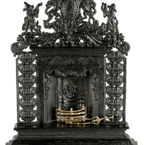 A VICTORIAN CAST IRON MINIATURE FIREPLACE MID 19TH CENTURY possibly a travelling…