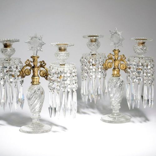 A PAIR OF CUT GLASS AND GILT BRASS TWIN LIGHT CANDELABRA C.1820 each with a swir…