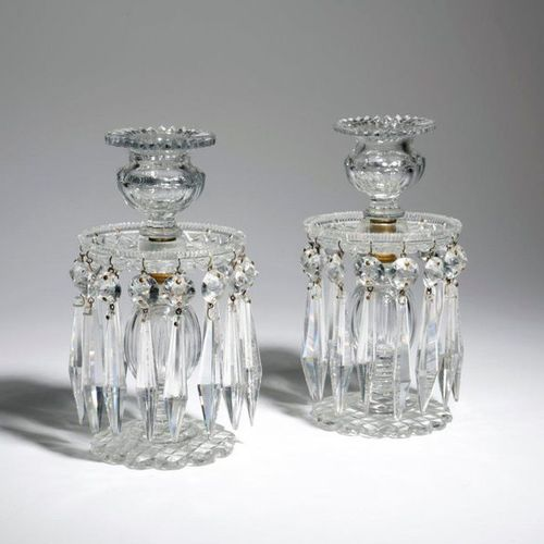 A PAIR OF CUT GLASS LUSTRE CANDLESTICKS C.1820 30 each with a faceted urn shape …