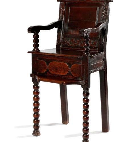 A WILLIAM AND MARY OAK CHILD'S HIGHCHAIR C.1690 the panelled back carved with sc…