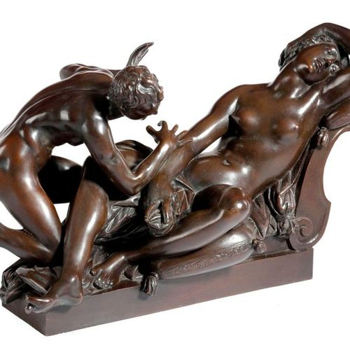 A BRONZE GRAND TOUR GROUP OF A SLEEPING NYMPH AND SATYR AFTER GIAMBOLOGNA (FLEMI…