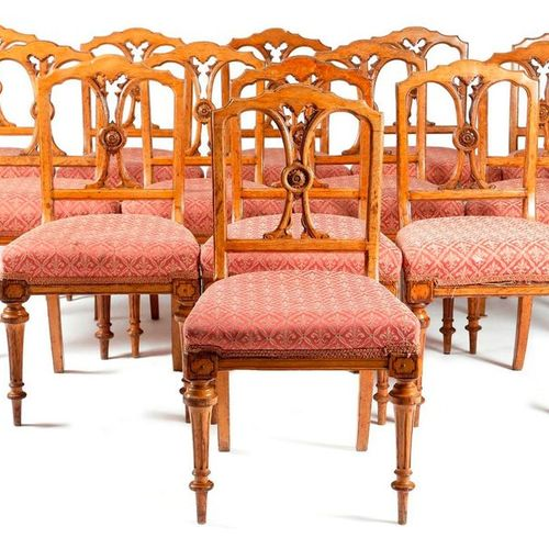 A SET OF THIRTEEN VICTORIAN OAK GOTHIC REVIVAL DINING CHAIRS C.1880 each with an…