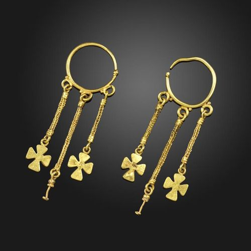 A pair of gold earrings in the Roman style, each with plaited drop sections susp…