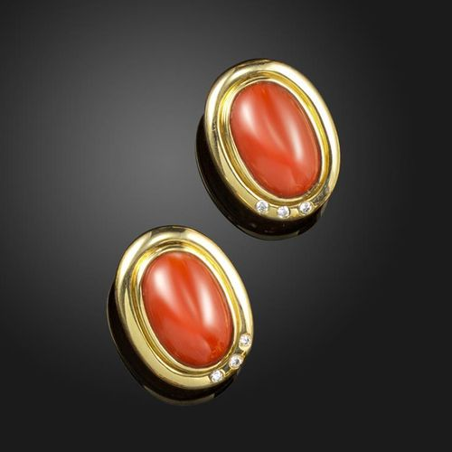 A pair of coral and diamond set gold earrings, the oval coral cabochons set with…