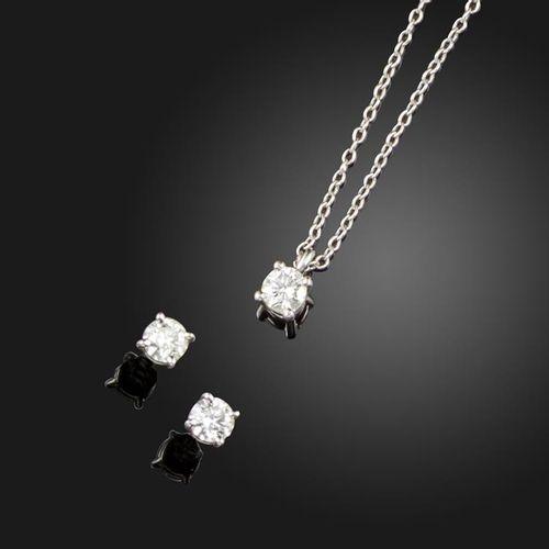 A pair of diamond stud earrings by Tiffany & Co., the round brilliant cut diamon…