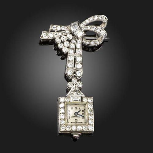 A diamond set fob watch, the stylised diamond set bow suspends a triangular diam…