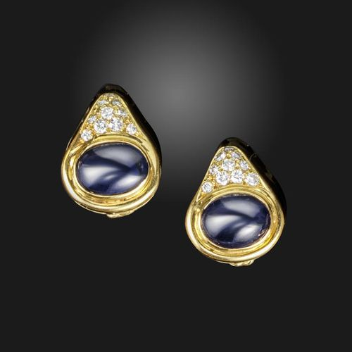 A pair of sapphire and diamond earrings, the oval cabochon sapphires each set wi…