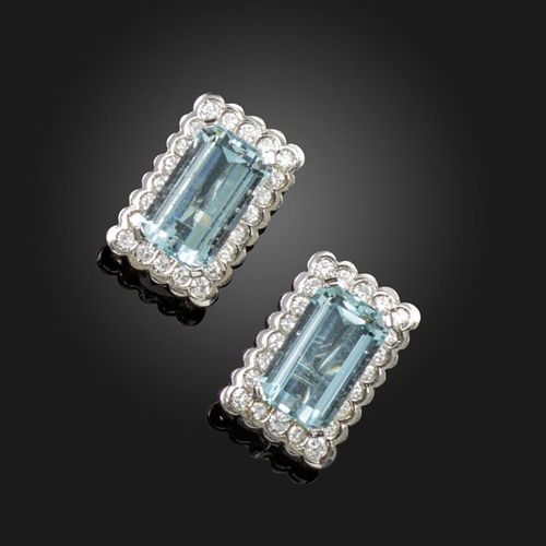 A pair of aquamarine and diamond cluster earrings, the emerald cut aquamarines a…