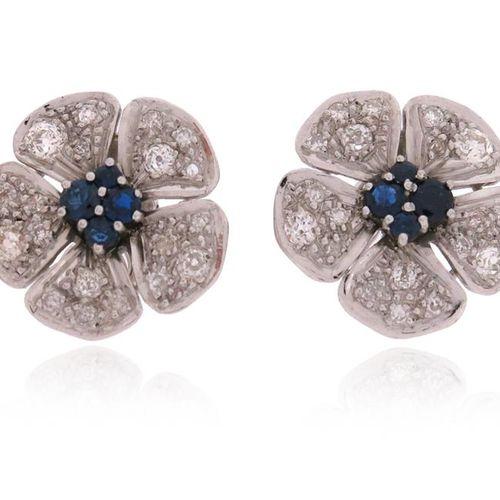 A pair of sapphire and diamond flowerhead earrings, centred with circular cut sa…