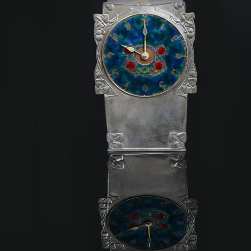 A Liberty & Co Tudric Pewter and enamel mantel clock designed by Archibald Knox,…