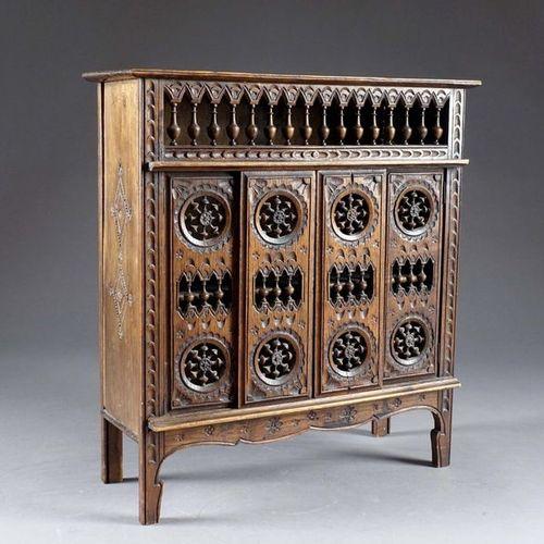 Armoire Bretonne en réduction. Sliding doors and turned bars. Carved wood. Dimen…
