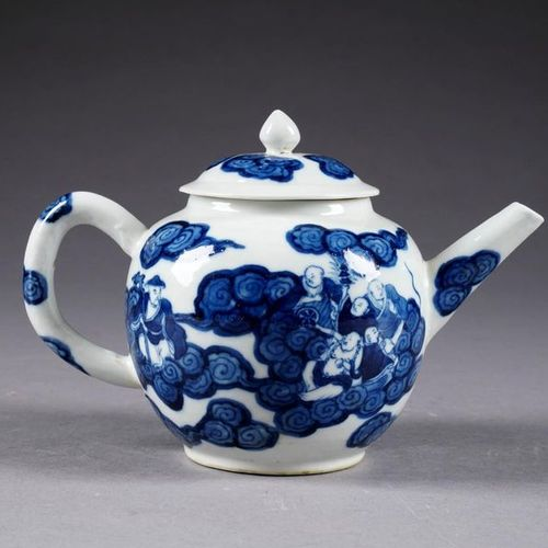 Théière. Decorated, in full and blue enamel, with Immortals in clouds. Chinese p…