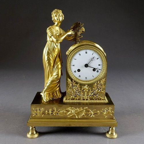 D'époque Empire. Pendulum with an enamelled dial inscribed in a bollard, accoste…