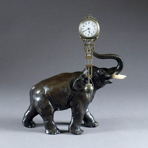Pendule à l'Eléphant. The animal holding a pendulum shaped clock at the end of i…