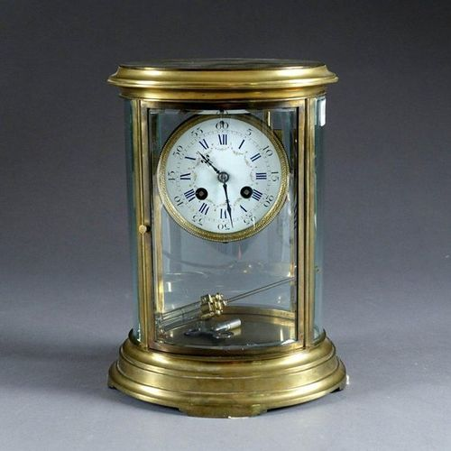 Pendule Cage de Forme ovale. Striking movement and enamelled dial bearing the Ma…